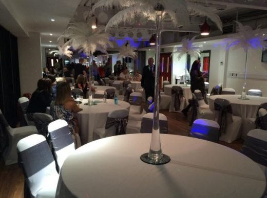 Image shows a room at FC United of Manchester decorated for a wedding
