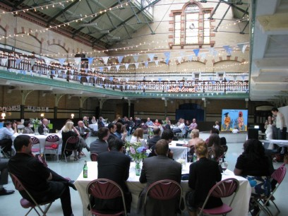 Image shows Victoria Baths with a weddning party seated for dinner