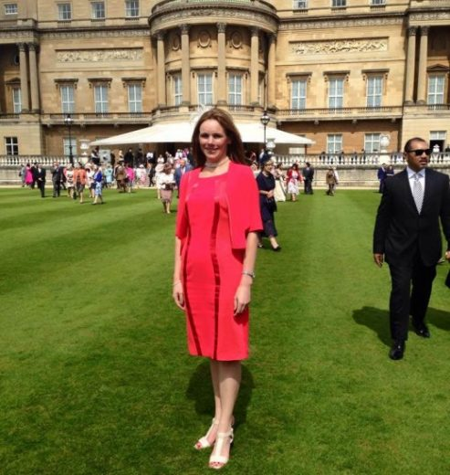 Ailsa, standing outside in the garden at Buckingham Palace