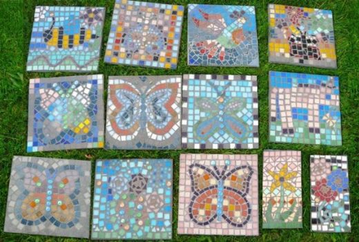 Hand made mosaic tiles laid out on grass