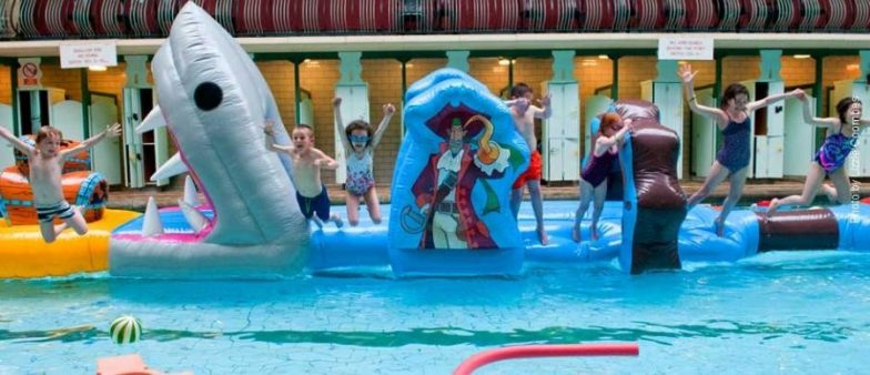 Children jumping into a pool
