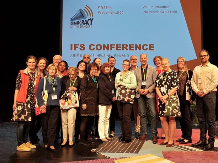 People on stage at the IFS conference