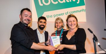 Winners of the Power of Community Award, Friends of Stretford Public Hall, accepting the award from Tony Armstrong