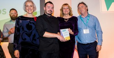 A group of people from Southern Brooks Community Partnerships accepting the Bringing Communities Together Award