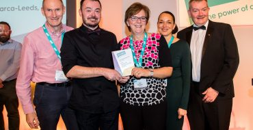 A team of people from Engage Leeds, accepting the Partnership Locality award.