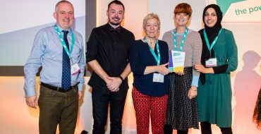 Members of staff from Halifax Opportunities Trust accepting the Enterprising Organisation Locality Award.